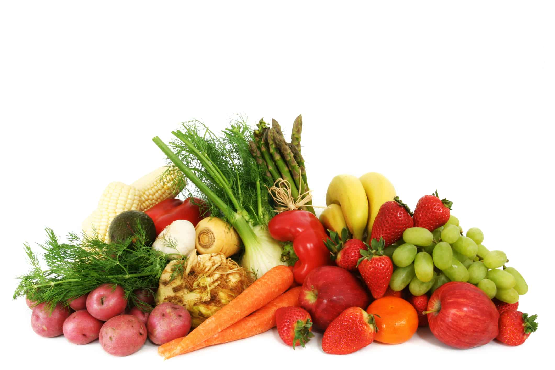 A pile of fresh, healthy fruits and vegetables isolated on white