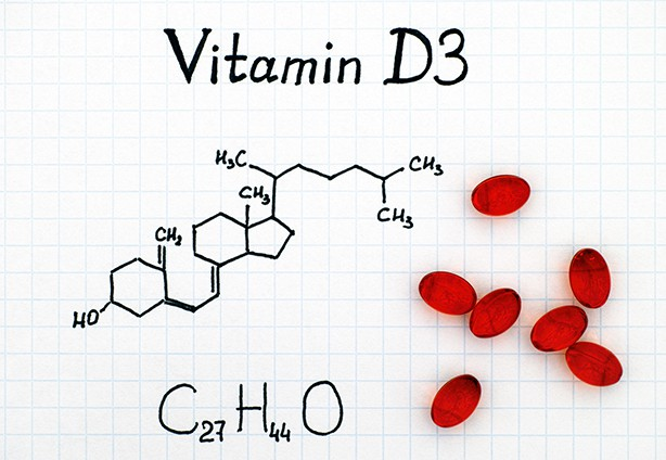 Chemical formula of Vitamin D3 and red pills.
