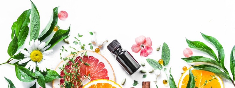 Essential oil for beauty skin. Flat lay beauty ingredients on a light background, top view. Beauty healthy lifestyle concept. Copy space