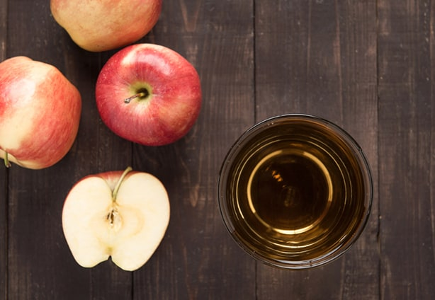 Top view healthy apple juice drink and red apples fruits on wooden background.
